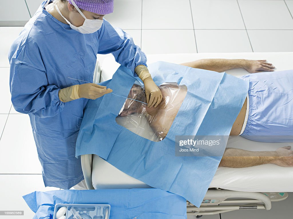 young man receiving central venous catheter : Stock Photo