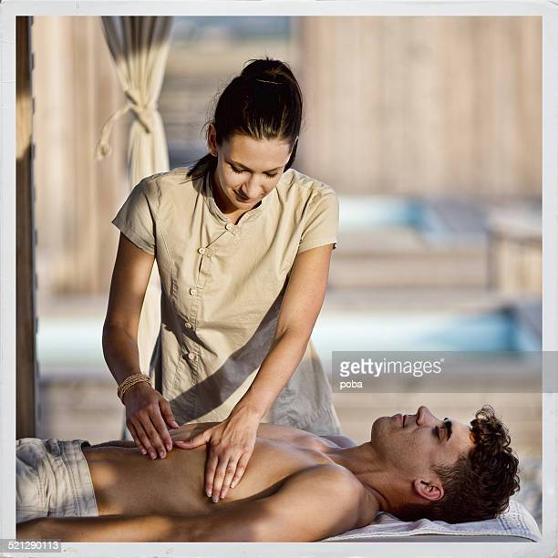 young man receiving   massage at spa and beauty salon - sensual massage stock photos and pictures