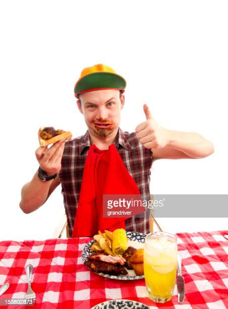 Young Man Red Necks Eating Barbeque