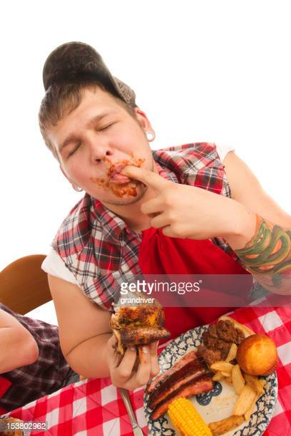 Young Man Red Necks Eating Barbeque Rib