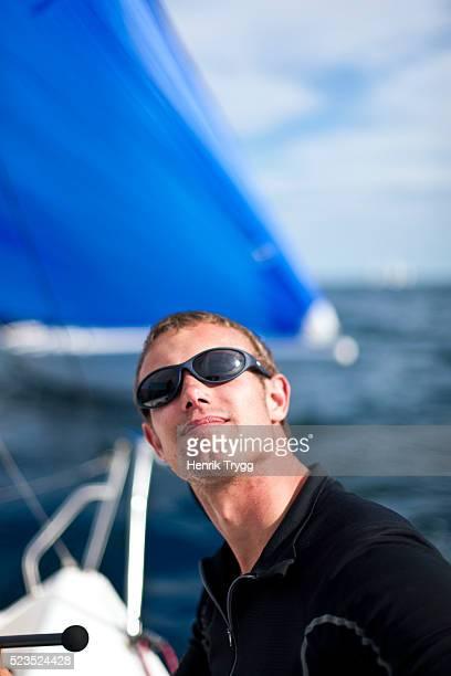 Young man regatta sailing
