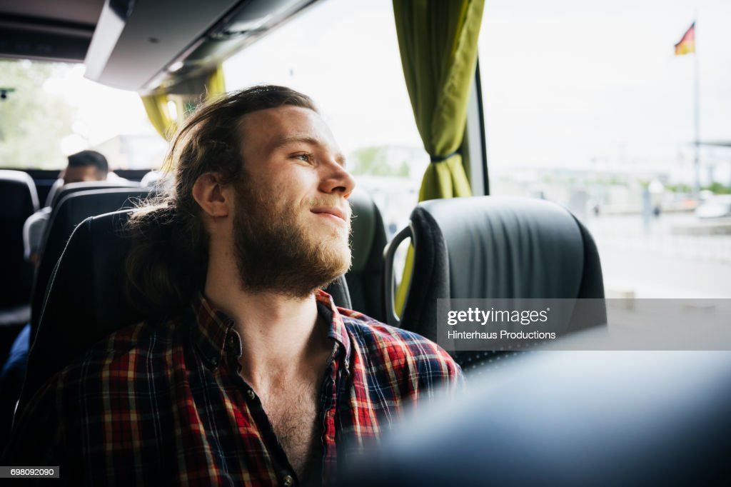 Young Man Relaxing During A Bus Trip : Stock-Foto