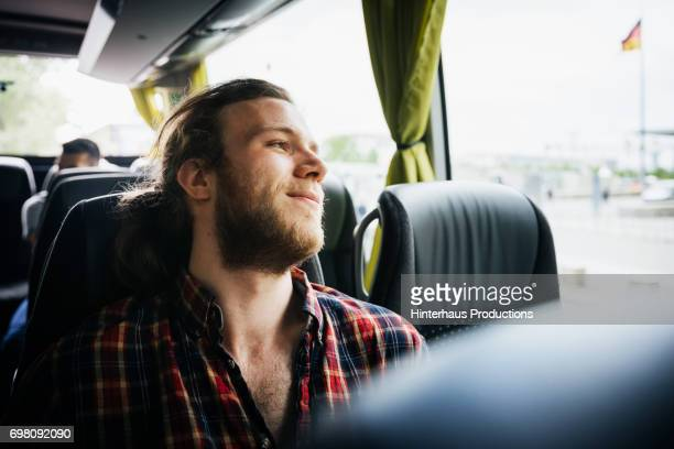 young man relaxing during a bus trip - gente serena foto e immagini stock