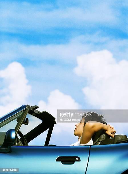 Young Man Relaxing In Car