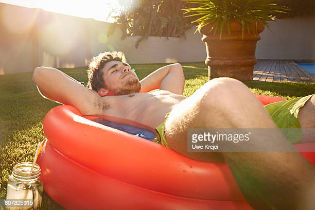 Young man relaxing in pool