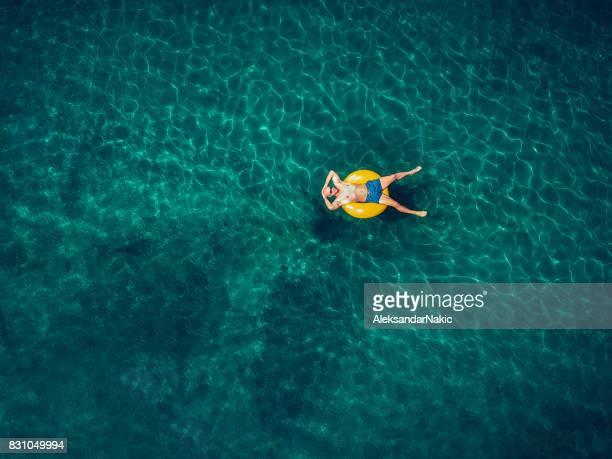 Young man relaxing in the ocean