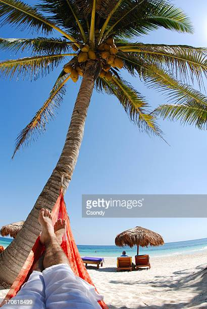Young man relaxing on a beautiful beach