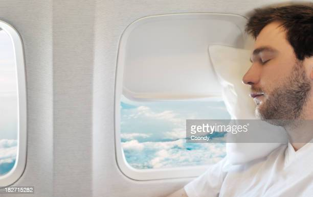 Young man relaxing on aircraft