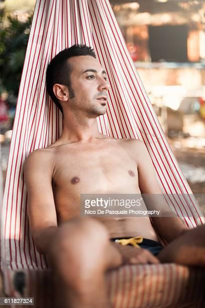 young man relaxing - ver a hora stockfoto's en -beelden