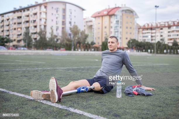 Young man resting after practice