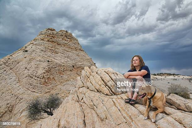 Young Man Resting with His Dog