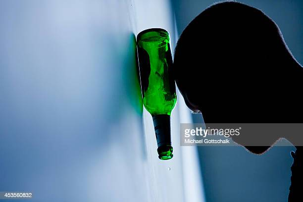 A young man rests his head on a beer bottle on August 13 2014 in Berlin Germany