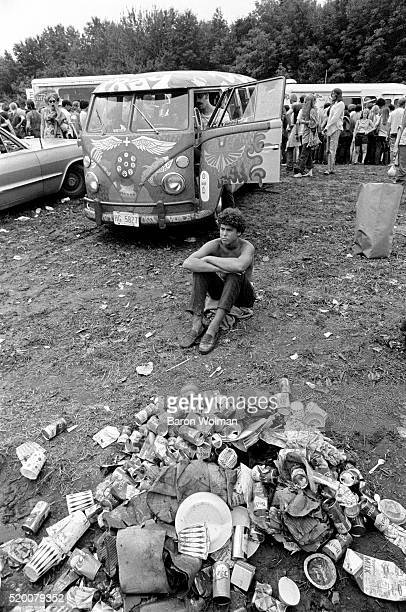 A young man rests on the ground at the Woodstock Music Art Fair celebrated in Bethel NY August 15 1969