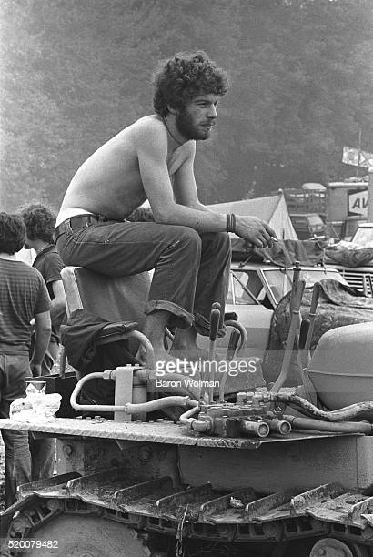 A young man rests on top of a tractor at the Woodstock Music Art Fair celebrated in Bethel NY August 15 1969