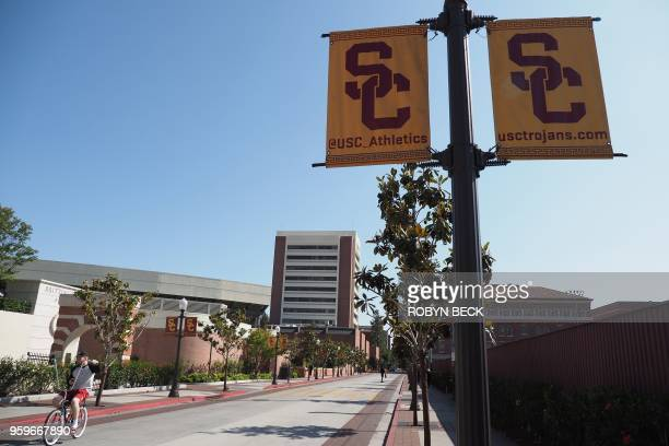 A young man rides a bicycle on the campus of the University of Southern California in Los Angeles California on May 17 2018 USC was in turmoil as it...