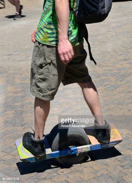 A young man rides his Onewheel electric skateboard in Vail Colorado