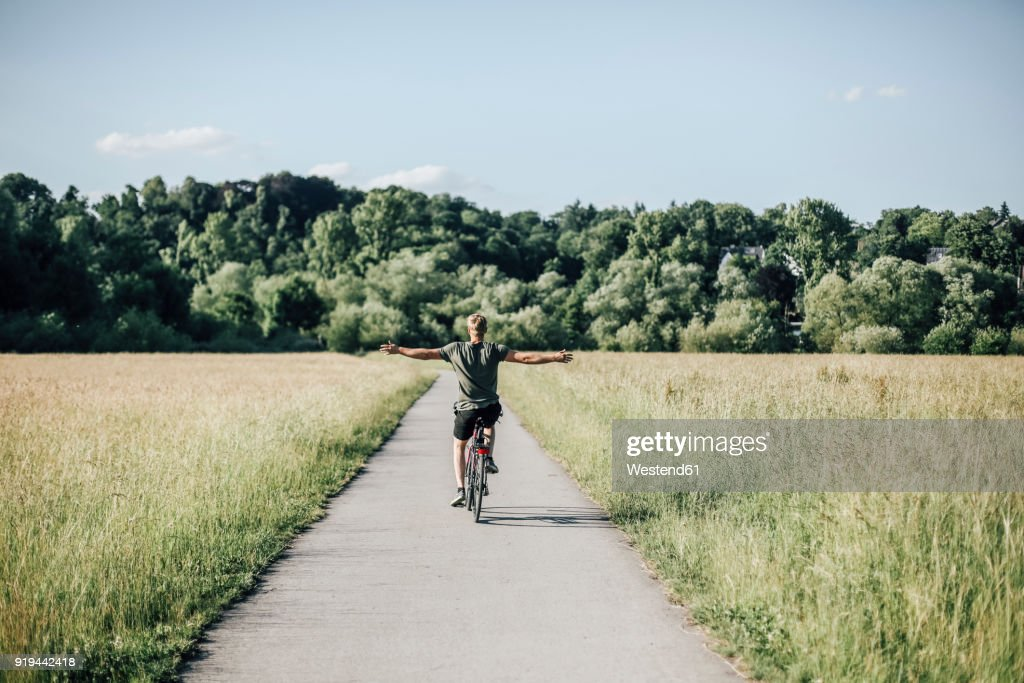 Young man riding a bike, freehand : Stock Photo