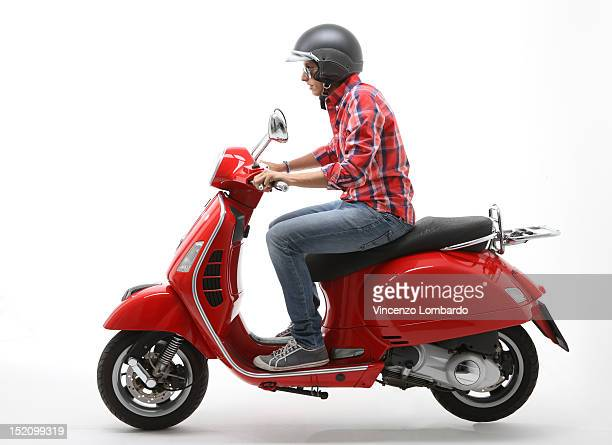 young man riding a scooter - sports helmet stock pictures, royalty-free photos & images