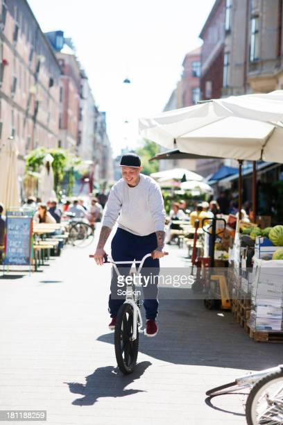 young man riding bicycle in city area