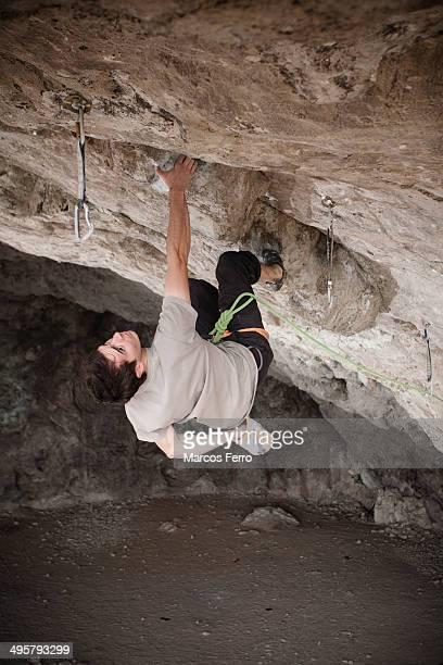 A young man rock climbing in Hidalgo, Mexico.