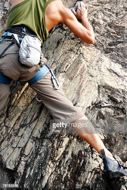 young man rock climbing - chalk bag stock pictures, royalty-free photos & images