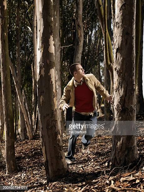 Young man running in woods