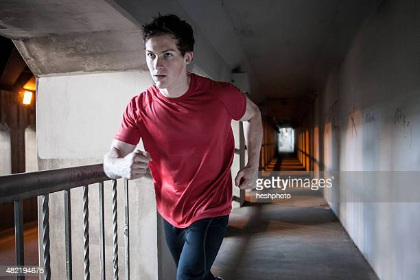 young man running on city bridge - heshphoto stock pictures, royalty-free photos & images
