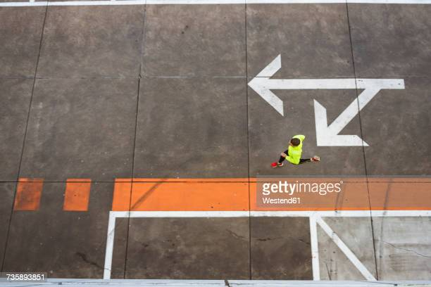 young man running on parking level - guidance stock pictures, royalty-free photos & images