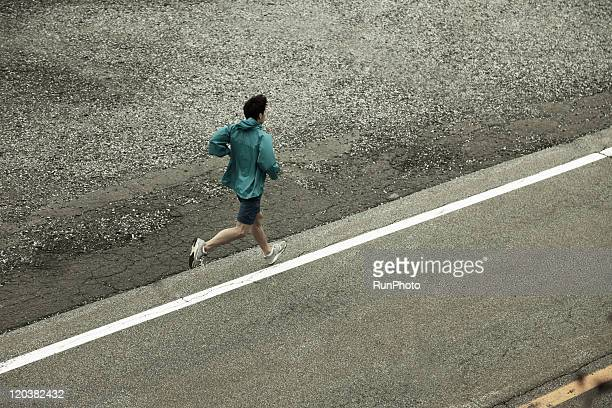 young man running - newhealth stock photos and pictures