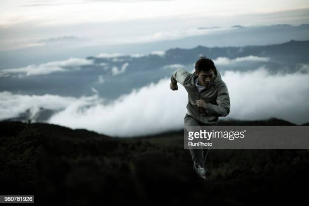 young man running up mt.fuji - active volcano stock pictures, royalty-free photos & images