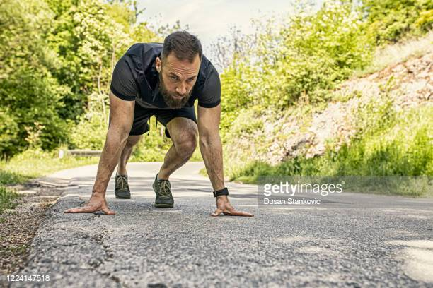 young man runs down the country road - dusan stankovic stock pictures, royalty-free photos & images