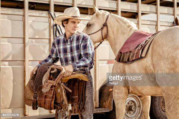 Young Man Saddles Up His Horse to Go for a Ride