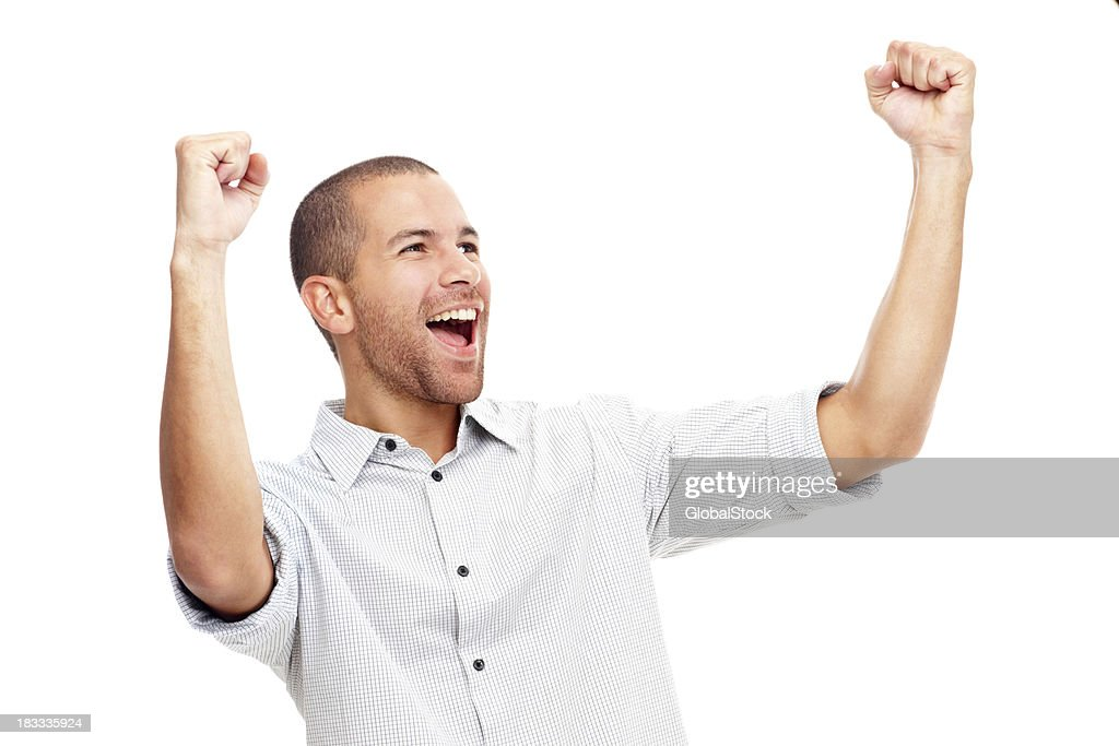 Young man screaming in excitement over white background : Stock Photo