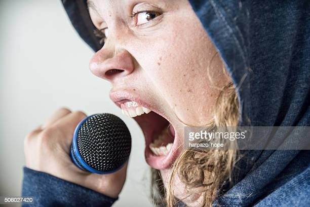 young man screaming into microphone - heavy metal stock pictures, royalty-free photos & images