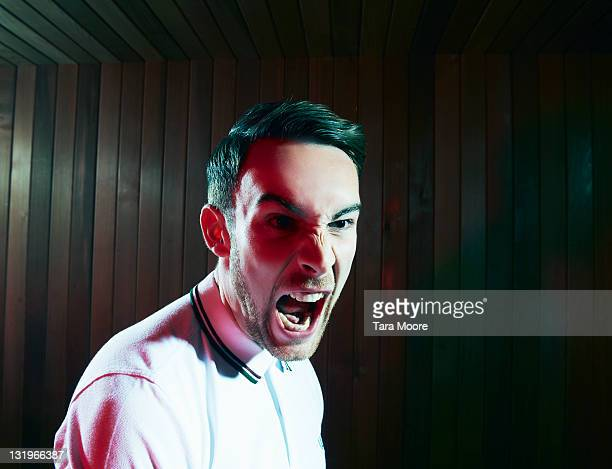 young man screaming with anger