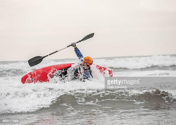 Young man sea kayaking