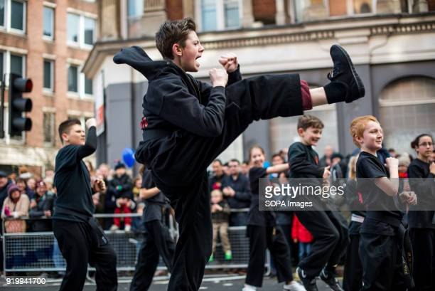A young man seen performing traditional chinese martial art on the Chinatown streets during the Chinese New Year celebration Chinese London community...