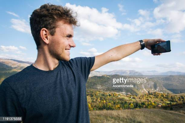 young man selfie  mountains - navy blue stock pictures, royalty-free photos & images