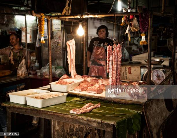 Young man selling fresh meat in Bangkok.