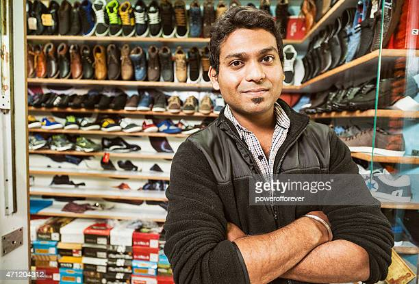 young man selling shoes at a shopping mall - indian ethnicity stock pictures, royalty-free photos & images