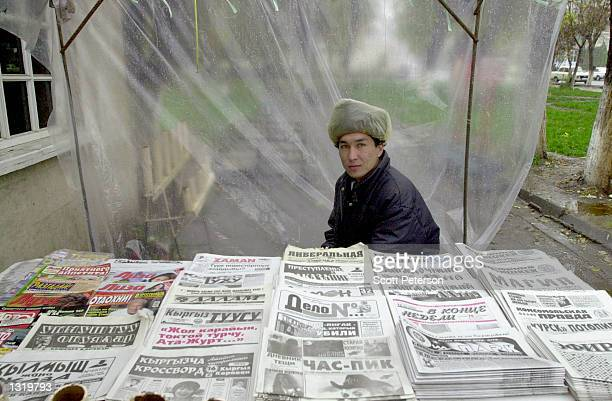 Young man sells newspapers at a market in November 2000 in Osh, Kyrgyzstan at the crossroads of the ancient Silk Road. The city of Osh in the Fergana...