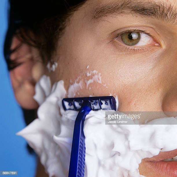 Young man shaving, close-up