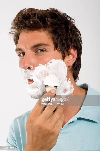young man shaving, portrait - shaving brush stock photos and pictures