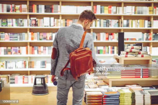 Young man shopping books