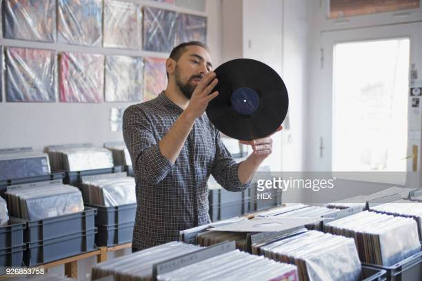young man shopping for records - record stock pictures, royalty-free photos & images