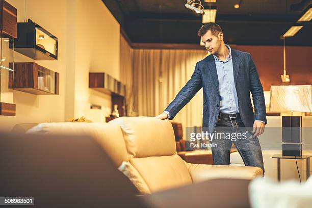 Young man shopping furniture