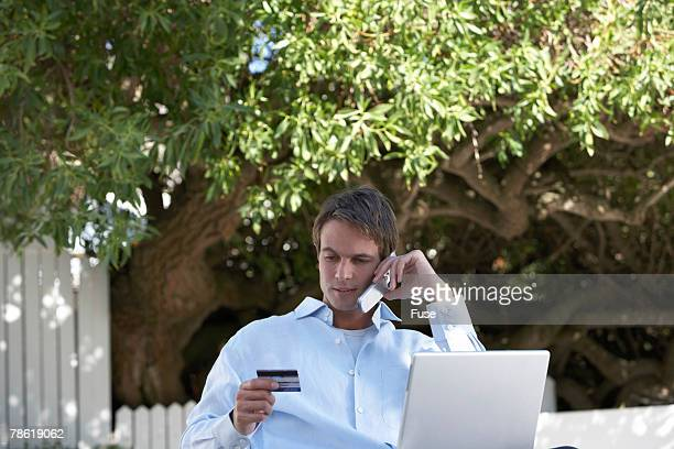 Young Man Shopping on the Internet