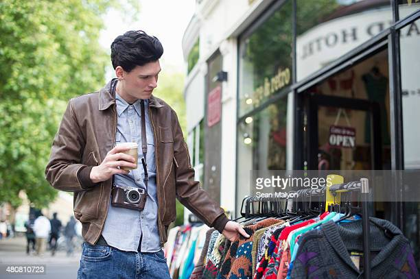 young man shopping - sean malyon stock pictures, royalty-free photos & images