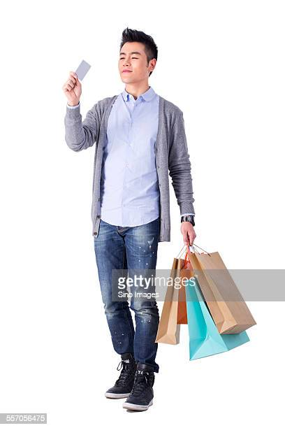 young man shopping - image stock pictures, royalty-free photos & images