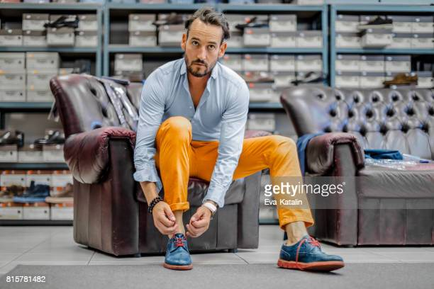 young man shopping shoes - blue shoe stock pictures, royalty-free photos & images